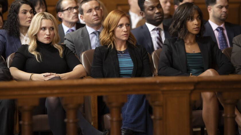 """Emily Osment, left, Brittany Snow and Megalyn Echikunwoke in """"Almost Family"""" on Fox."""