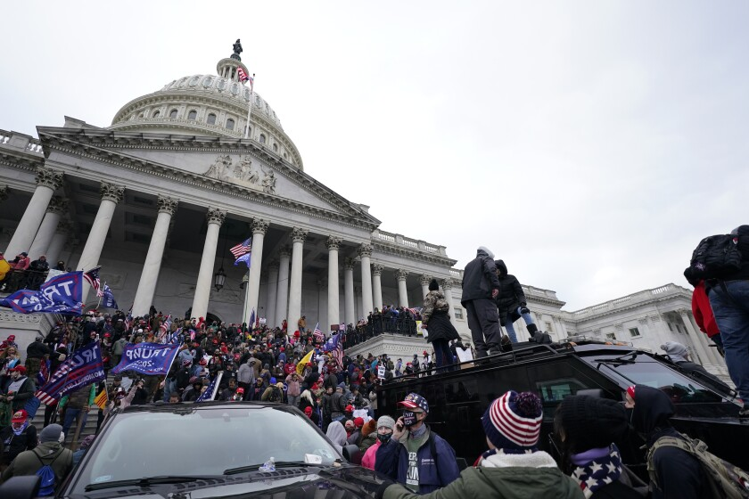 Trump supporters stand on top of a police vehicle Wednesday at the U.S. Capitol.