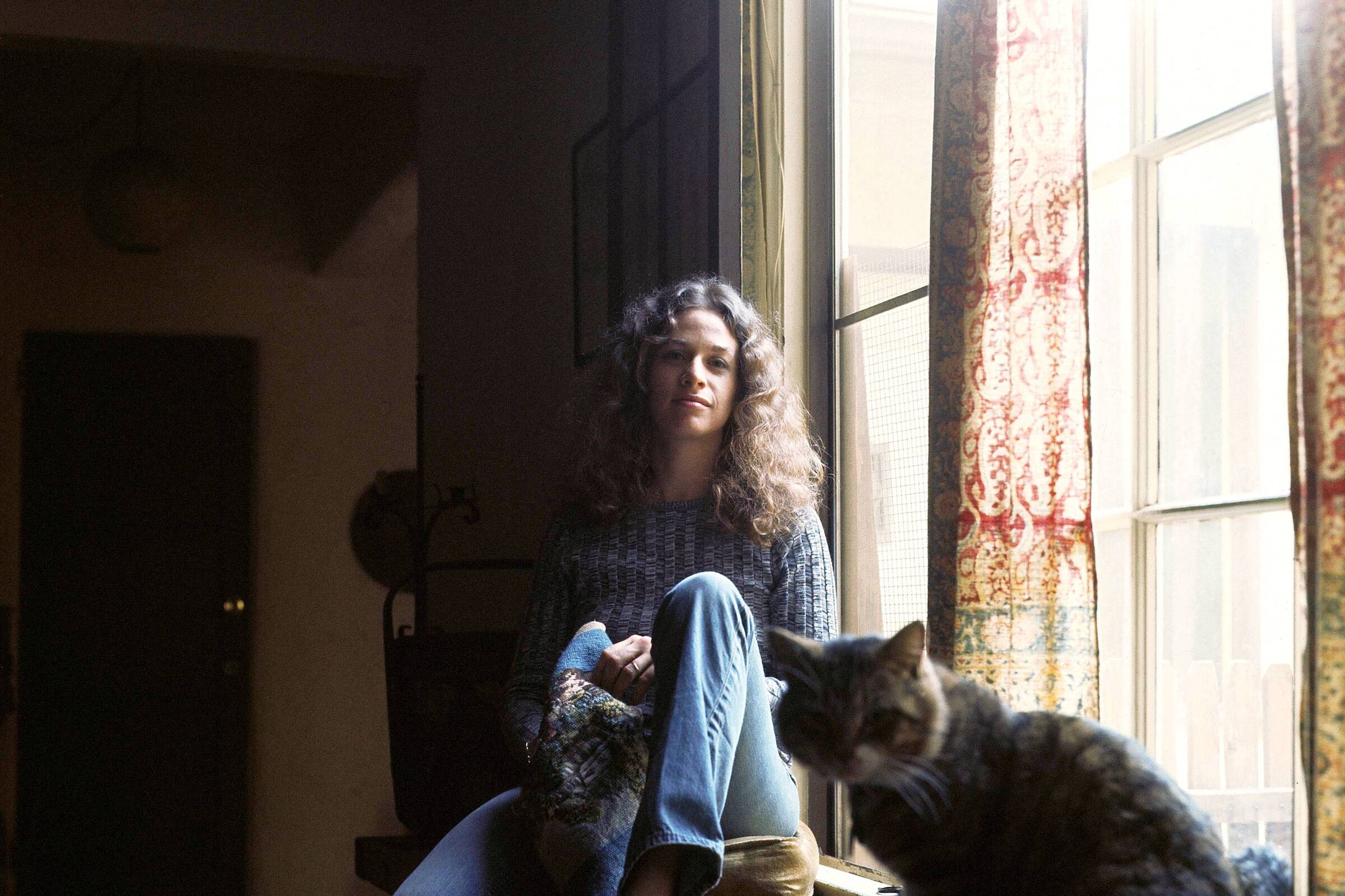 "Carole King and her friend Telemachus during the photo shoot for the ""Tapestry"" album cover."