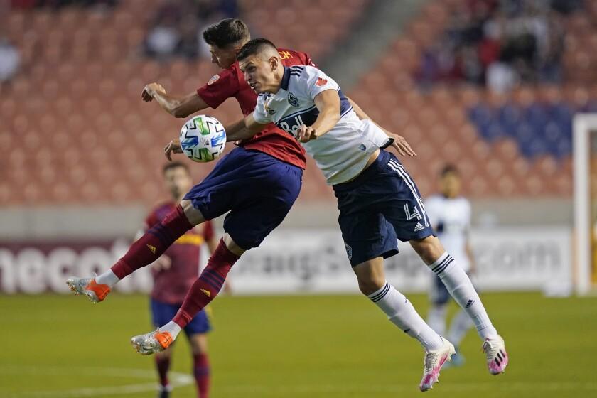 Real Salt Lake midfielder Damir Kreilach, rear, defends against Vancouver Whitecaps defender Ranko Veselinovic (4) in the first half during an MLS soccer match Saturday, Sept. 19, 2020, in Sandy, Utah. (AP Photo/Rick Bowmer)