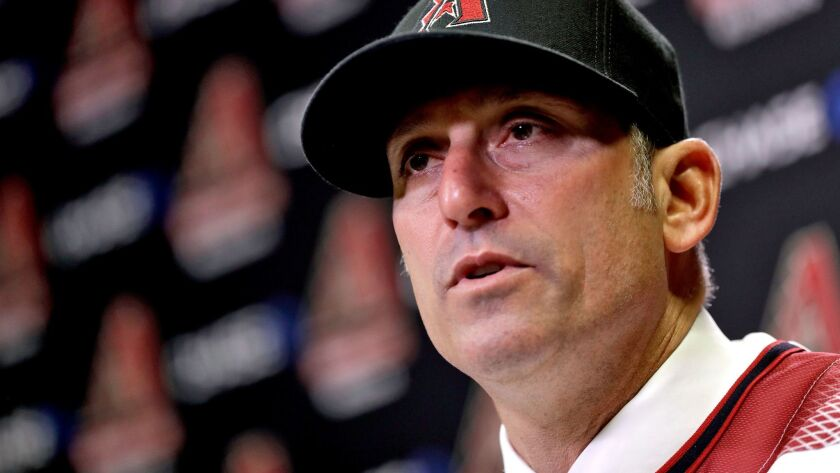Diamondbacks manager Torey Lovullo speaks to the media at an introductory press conference at Chase Field. After G.M. Dave Stewart and manager Chip Hale were fired following last season's disappointing 69-93 campaign, Arizona snagged GM Mike Hazen and Lovullo from Boston.