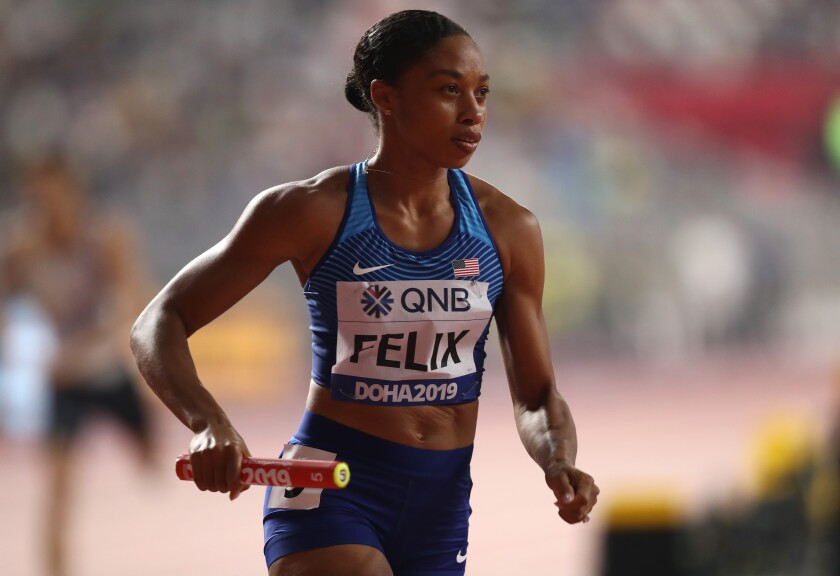 Allyson Felix competes in the 400-meter relay at the IAAF World Athletics Championships on Sunday.