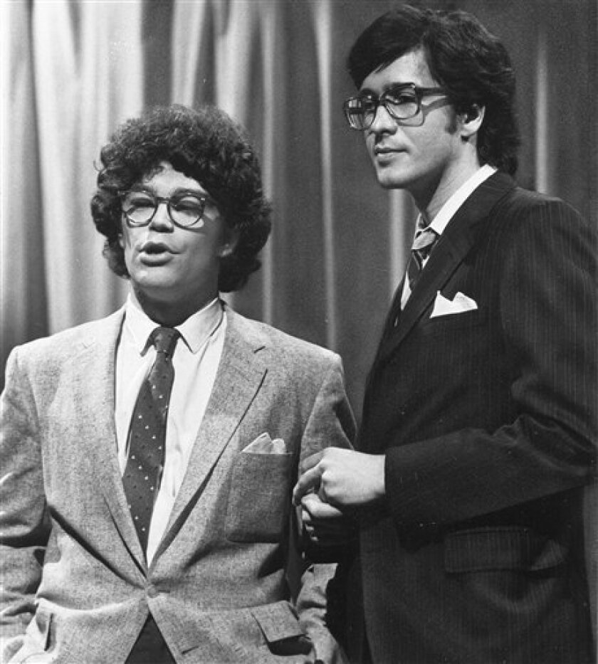 """FILE - This 1978 file photo from NBC shows """"Saturday Night Live"""" writer/performers Al Franken, left, and Tom Davis in New York. Davis, a writer and performer who with Franken developed some of the most popular skits in the early years of ìSaturday Night Live,"""" died Thursday, July 19, 2012. He was 59. (AP Photo/NBC-TV, File)"""