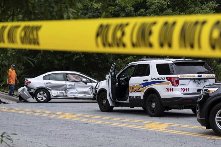A wrecked car is removed from the scene where police fatally shot a man in downtown Decatur, Ga. on Tuesday morning, May 18, 2021. (AP Photo/Ben Gray)