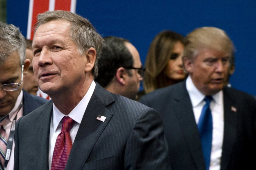 FILE - In this Feb. 6, 2016, file photo, Ohio Gov. John Kasich, left, and Donald Trump, right, speak to reporters after a Republican presidential primary debate hosted by ABC News at Saint Anselm College in Manchester, N.H. While Trump is bypassing the NAACP national convention taking place in Cincinnati from Saturday to Wednesday, July 16 to 20, a Kasich spokeswoman confirmed Friday, July 15, 2016, that the governor will speak to the NAACP on Sunday, July 17 a day before Hillary Clinton's speech to the NAACP and the start of the Republican National Convention in Cleveland. (AP Photo/Matt Rourke, File)