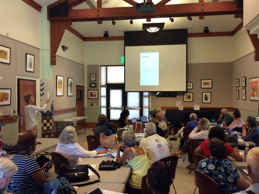 Communicating with Technology class instructor Mary Burns teaches attendees how to set up email accounts on mobile devices at Serra Mesa-Kearny Mesa Library.