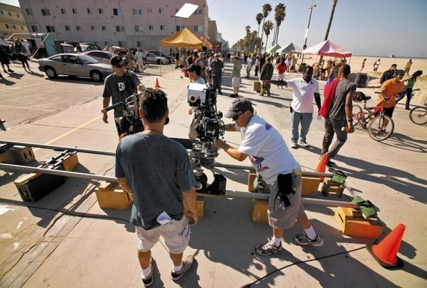 "A report by the Los Angeles 2020 Commission offers various prescriptions to promote jobs in L.A. but says nothing about how to boost employment in the entertainment industry. Above, a crew films a scene for ""NCIS: Los Angeles"" in Venice."