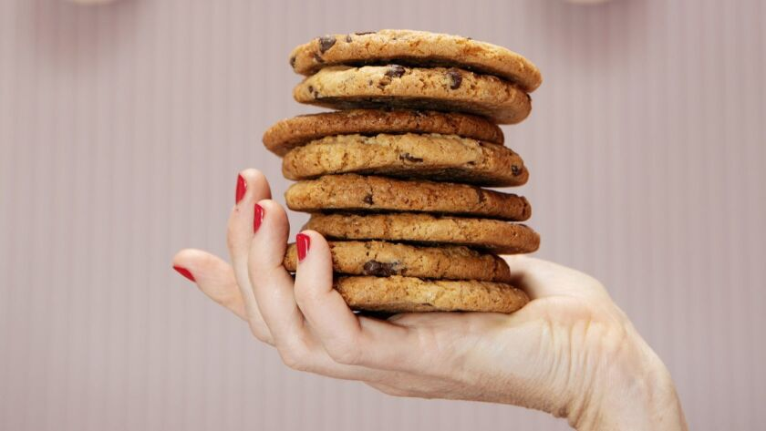 Erin McKenna displays a stack of her bestselling chocolate chip cookies in her bakery. You can bake them at home too.