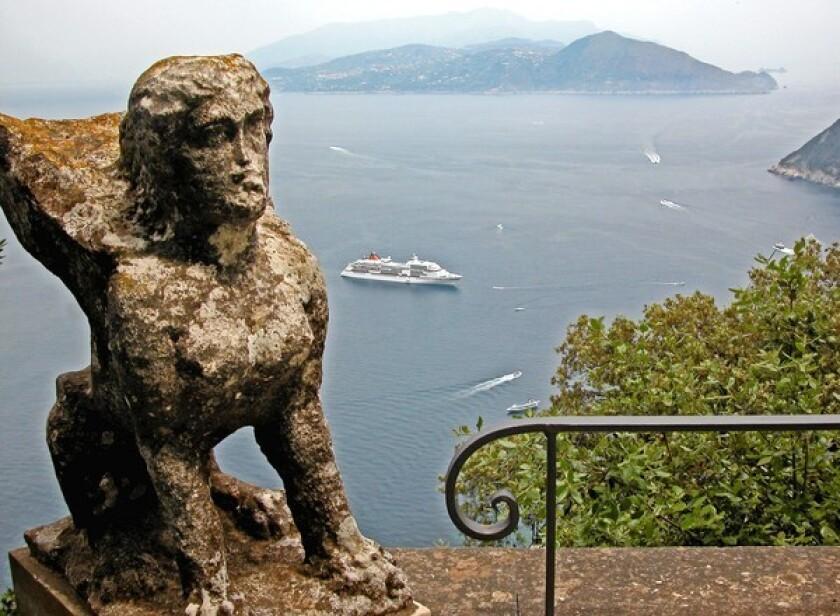 A ship sails toward Capri, Italy, far below this viewpoint at the Villa San Michele, one of Capri's most popular tourist destinations.