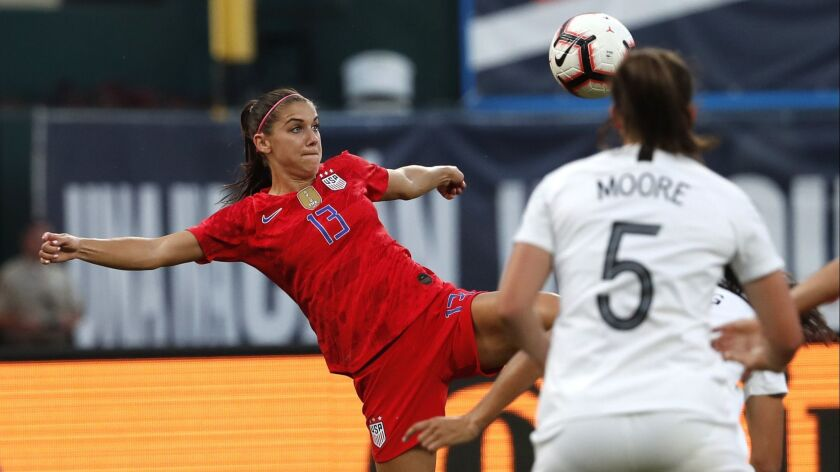United States' Alex Morgan keeps he eye on the ball during the first half of an international friend