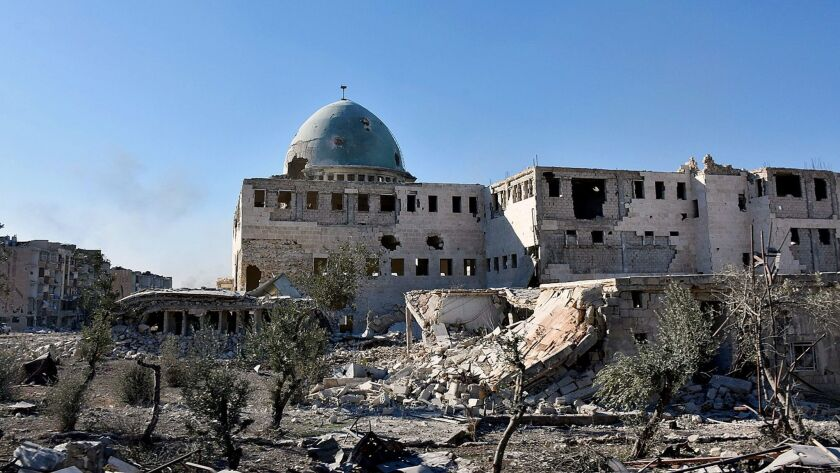 A damaged mosque and buildings in eastern Aleppo, Syria, are seen in a picture provided by the official Syrian Arab News Agency on Nov. 27, 2016.