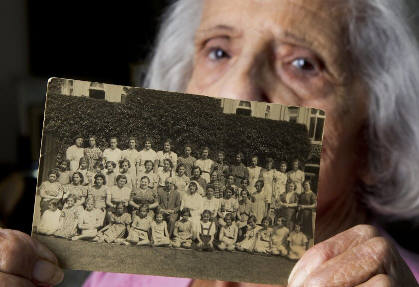 Lotti Blumenthal of Rancho Bernardo holds a photo that includes her, fifth from the left in the back row, at Burges Hill, in Sussex, England, where she stayed during part of World War II after being rescued from the Nazis as part of the Kindertransport program. Thousands of Jewish children from her native Germany, Austria, Czechoslovakia, Poland, and the Free City of Danzig were sent to the United Kingdom during the war to avoid the Nazi death camps.