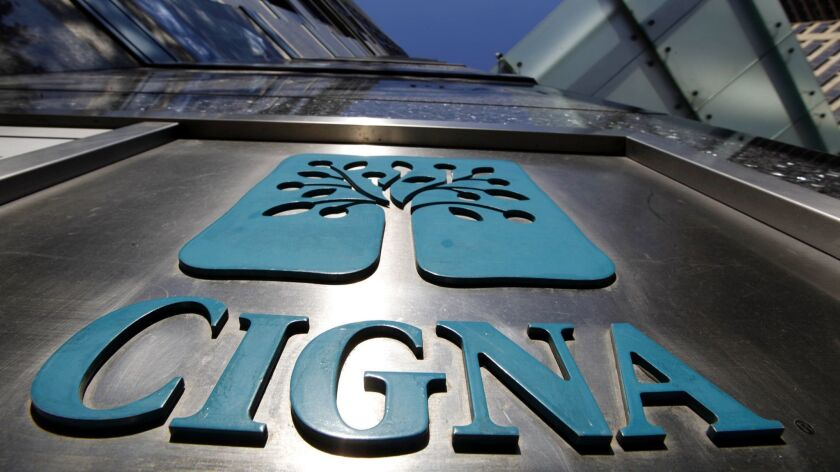 Cigna's deal to acquire Express Scripts is on track to wrap up by year's end, the companies said.