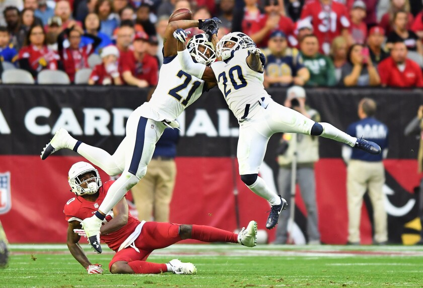 Rams' Aqib Talib (21) and Lamarcus Joyner try to intercept a pass in front of Arizona Cardinals receiver Chad Williams in the fourth quarter at State Farm Stadium on Sunday.