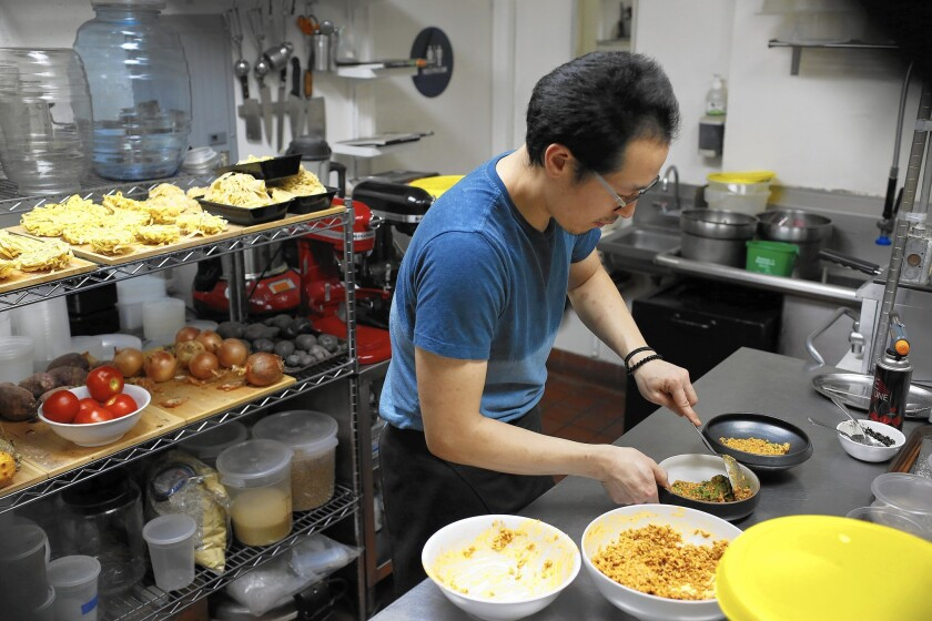 Kwang Uh works in the Baroo kitchen