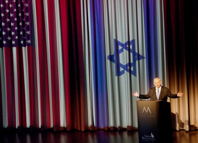 Israeli Prime Minister Benjamin Netanyahu, seen here giving a speech at the Simon Wiesenthal Center's Museum of Tolerance in Los Angeles, will speak to Congress on Tuesday about Iran.