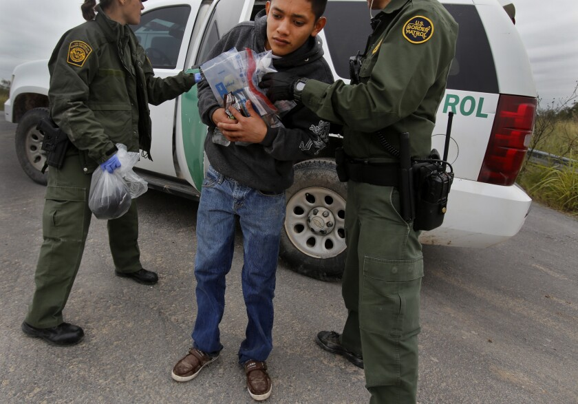 Border Patrol agents apprehend immigrants, mostly from Central America, along the Texas/Mexico border near McAllen, Texas.