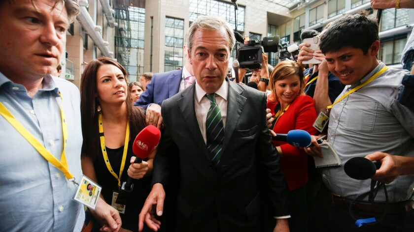 Nigel Farage, leader of the United Kingdom Independence Party (UKIP), speaks to reporters in the atrium main press room at the European Summit in Brussels, Belgium on June 28.