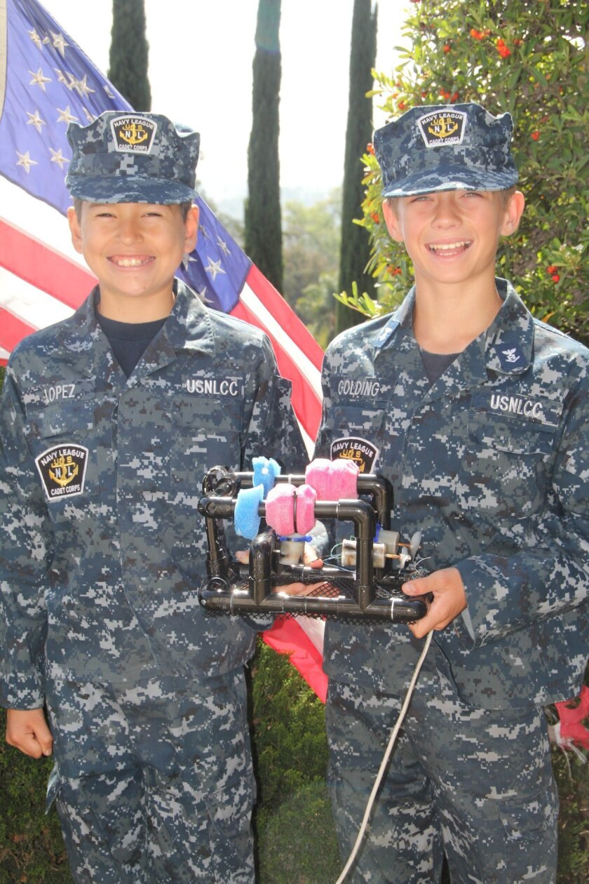 Naval Sea cadets, Brent Lopez (left) and Devon Golding will represent the Southwest Region of Sea Cadet Corps in a national sea perch competition. Click on photo to get whole picture.
