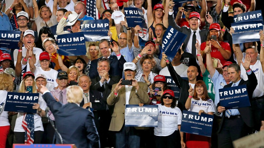 Republican presidential candidate Donald Trump pauses as he speaks to acknowledge some of his supporters at a rally in Phoenix, Ariz. on June 18.