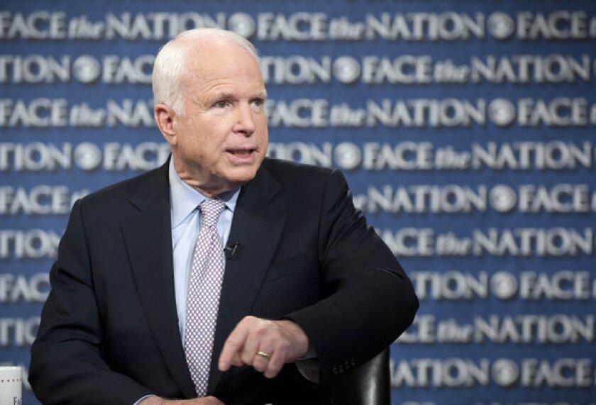 """Sen. John McCain (R-Ariz.) talks about the U.S. response to Syria on CBS's """"Face the Nation"""" in Washington on Sunday."""
