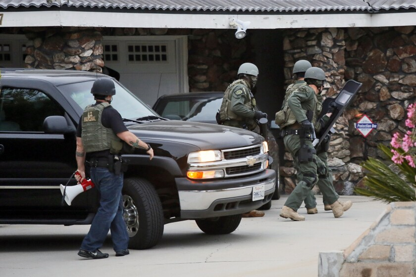 In this file photo, U.S. marshals raid a home in Montebello as part of Operation Sudden Impact.