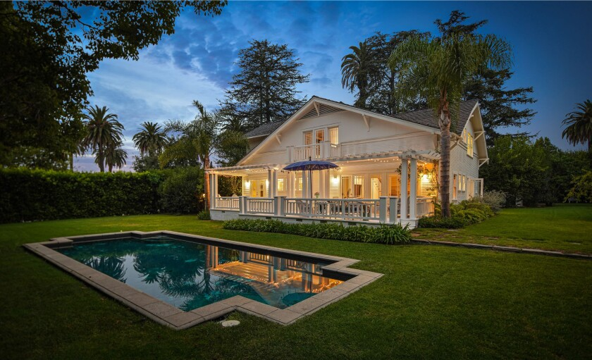 The half-acre estate includes a 99-year-old Craftsman, one-bedroom guesthouse and rustic barn surrounded by gardens.