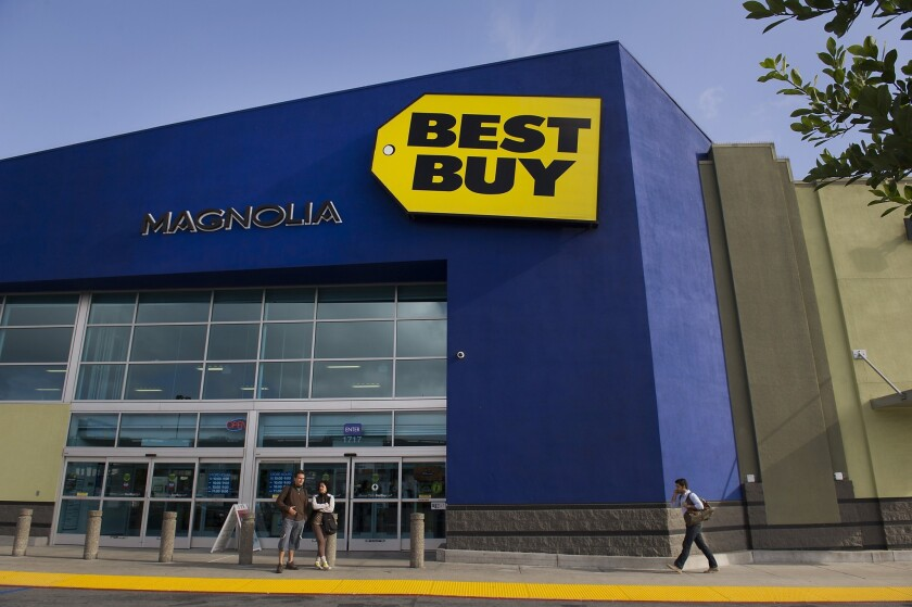 Customers stand outside a Best Buy store in San Francisco in May.