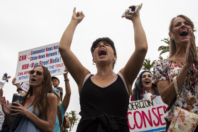 ReOpen San Diego demonstrators protest COVID-19 restrictions at the San Diego County Administration Building on Tuesday.