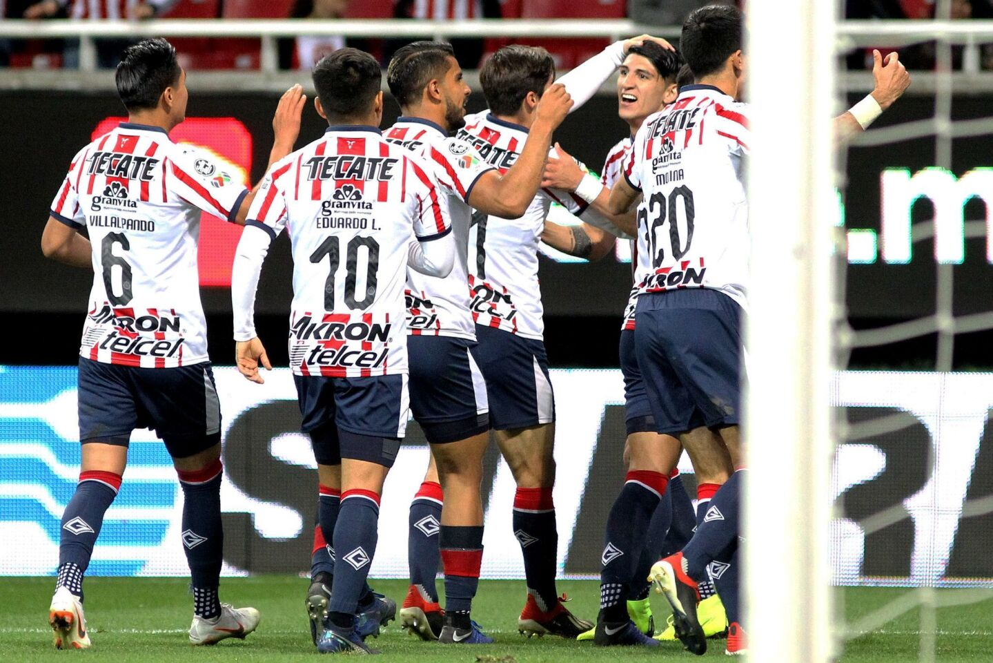 Alan Pulido (R) of Guadalajara celebrates his goal against Tijuana with teammates during their Mexican Clausura 2019 tournament football match at Akron stadium in Guadalajara, Jalisco State, Mexico on January 5, 2019. (Photo by Ulises Ruiz / AFP)ULISES RUIZ/AFP/Getty Images ** OUTS - ELSENT, FPG, CM - OUTS * NM, PH, VA if sourced by CT, LA or MoD **