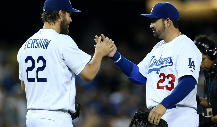 With the Dodgers' top three pitchers, including ace Clayton Kershaw, scheduled to face the Giants this weekend in San Francisco, first baseman Adrian Gonzalez (23) admits it's a three-game series that L.A. 'must' win.
