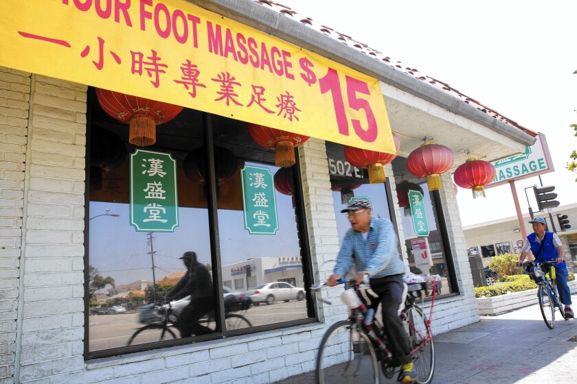 Massage parlors have flourished in the San Gabriel Valley. California cities are weighing how to regulate such businesses.