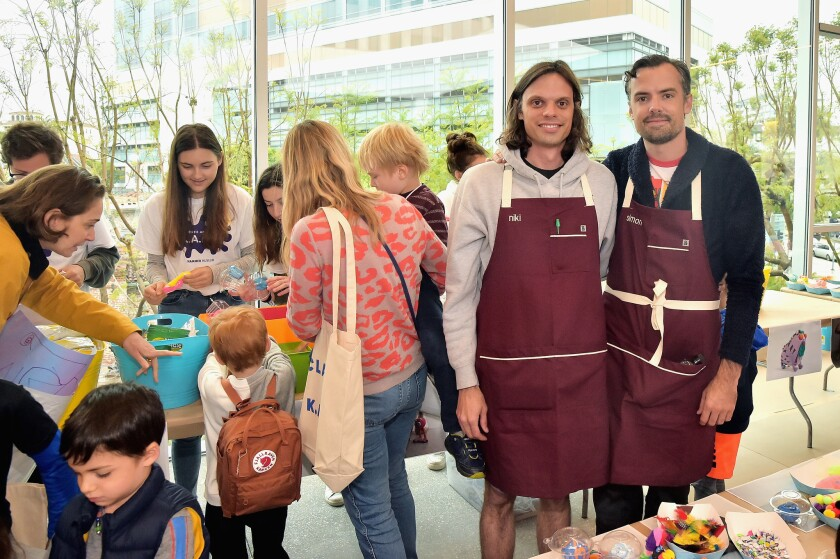 Brothers Nikolai and Simon Haas helped children make clay sculptures.