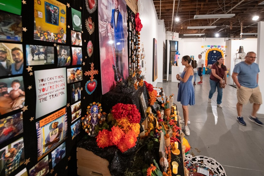 A flower- and photo-bedecked Day of the Dead altar