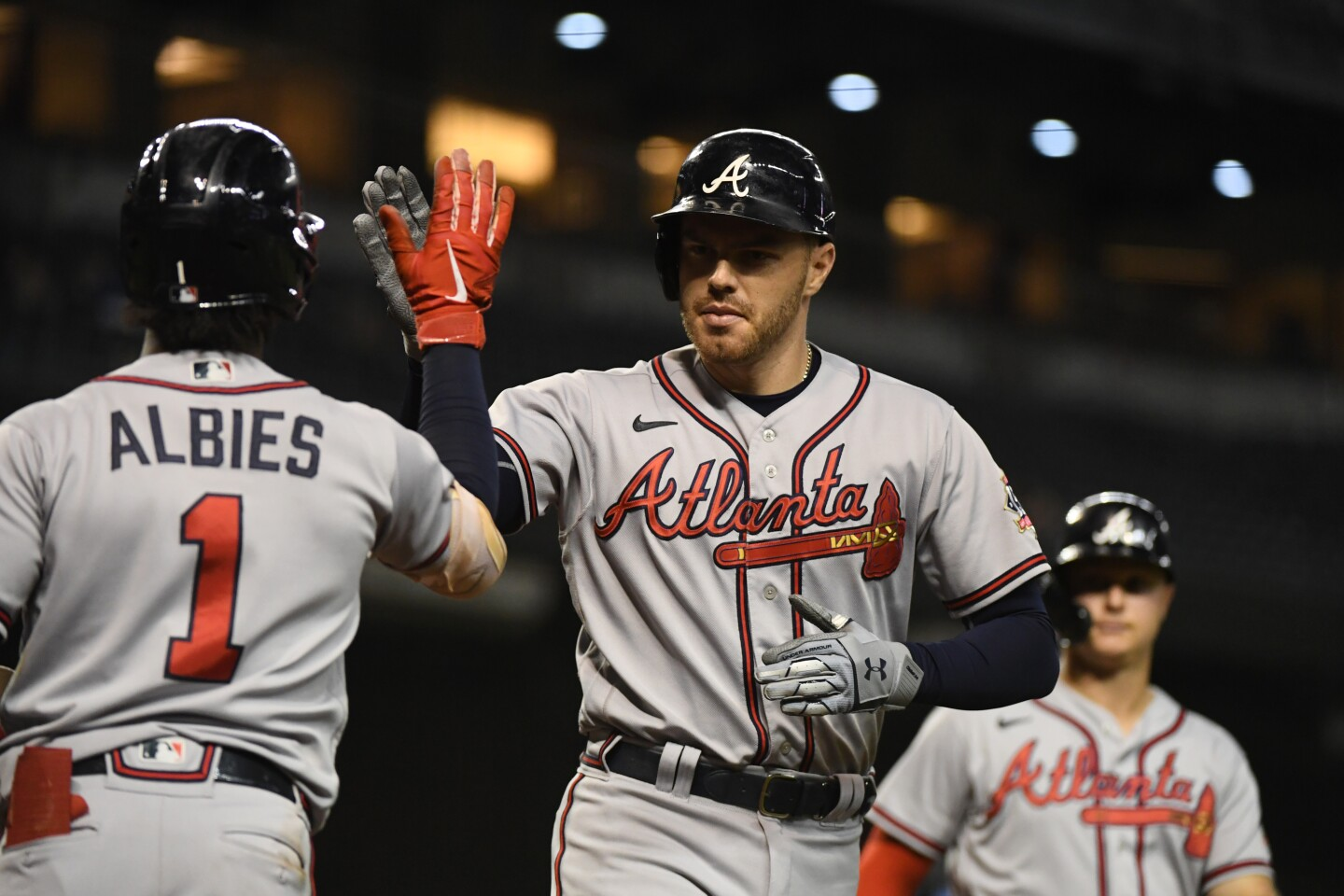 PHOENIX, ARIZONA - SEPTEMBER 22: Freddie Freeman #5 of the Atlanta Braves celebrates with Ozzie Albies #1 after hitting a two-run home run off Tyler Clippard #36 of the Arizona Diamondbacks during the ninth inning at Chase Field on September 22, 2021 in Phoenix, Arizona. (Photo by Norm Hall/Getty Images)