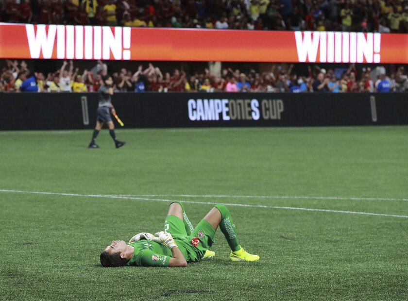 Club America goalkeeper Oscar Jimenez falls to the ground in defeat as Atlanta United wins the Campeones Cup as time expires with a 3-victory on Wednesday, Aug. 14, 2019, in Atlanta. (Curtis Compton/Atlanta Journal-Constitution via AP)