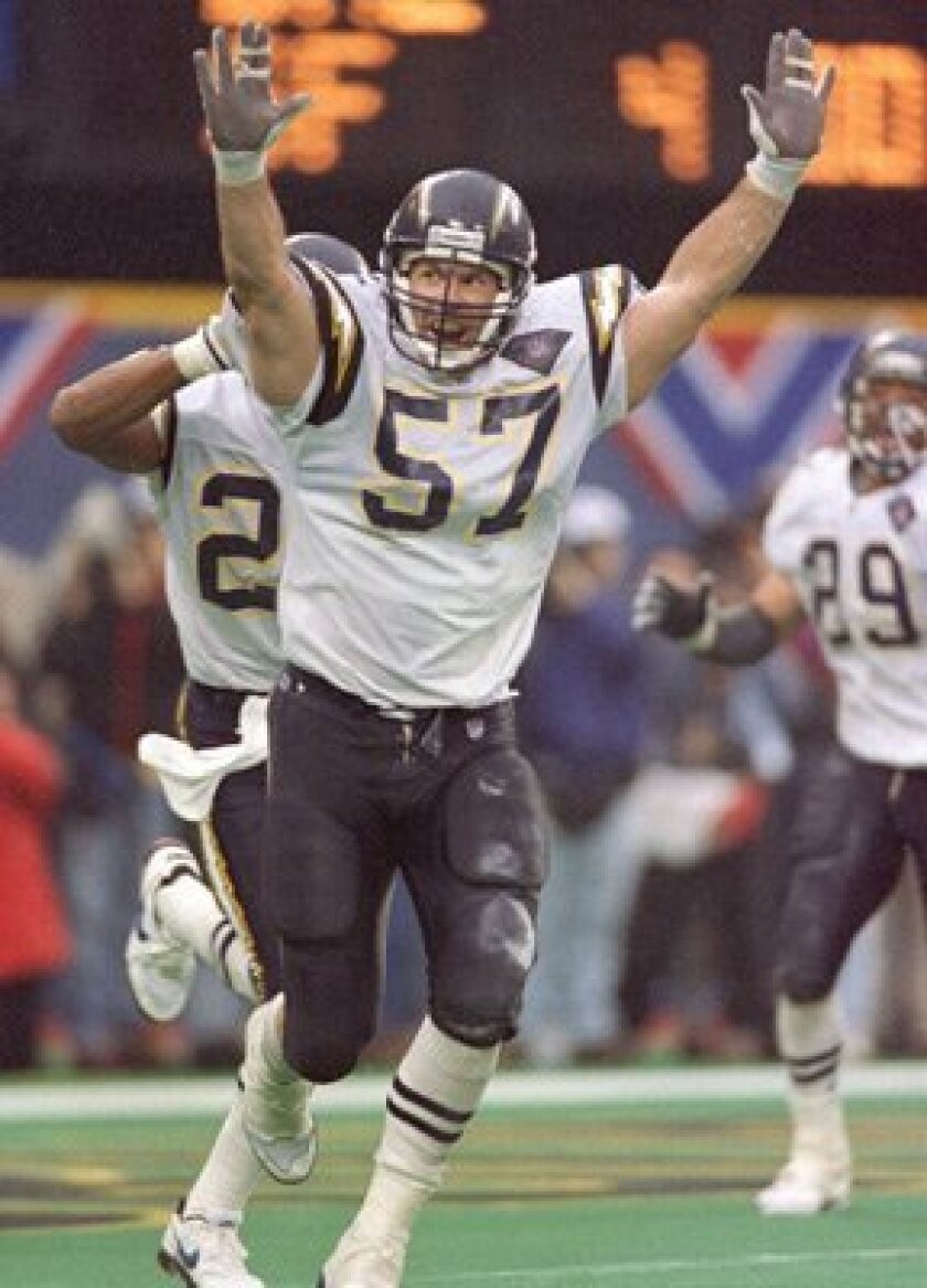 Chargers' Dennis Gibson celebrates after making winning defensive play at the 1995 AFC Championship Game.