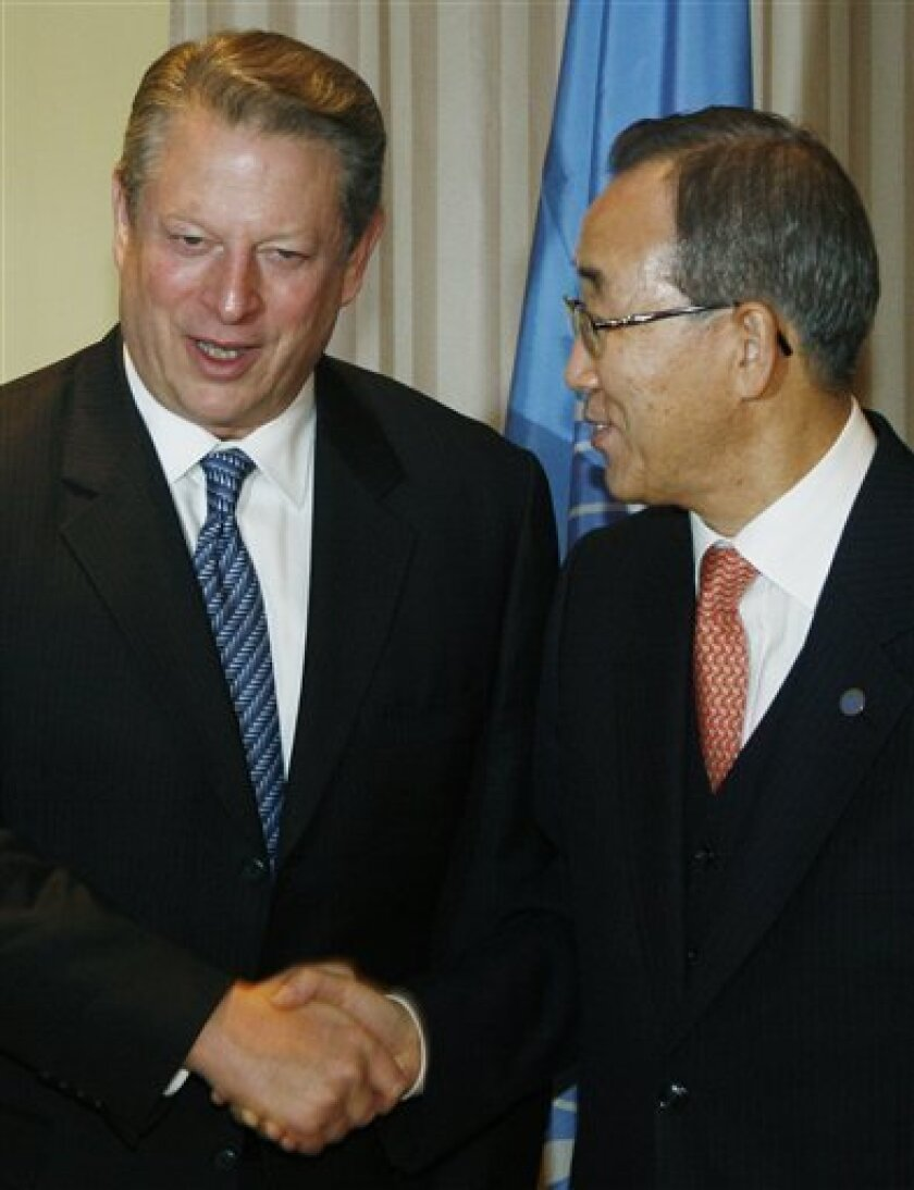 UN Secretary General Ban Ki-moon, right, shakes hands with former U.S. Vice President Al Gore, during the U.N. climate meeting in Poznan, Poland, Thursday, Dec. 11, 2008. (AP Photo/Czarek Sokolowski)