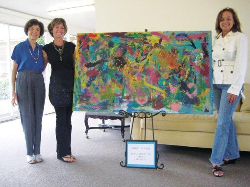 Elaine Leon, Jane Wheeler and Dona Aumann Pose with the Riford Center's collaborative work.