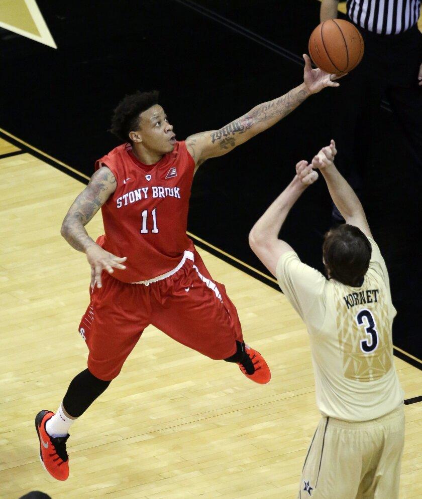Stony Brook forward Rayshaun McGrew (11) drives against Vanderbilt forward Luke Kornet (3) during the first half of an NCAA college basketball game Thursday, Nov. 19, 2015, in Nashville, Tenn. (AP Photo/Mark Humphrey)