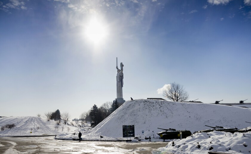 A visitor walks through a memorial park that is part of a World War II museum complex in Kiev, Ukraine.