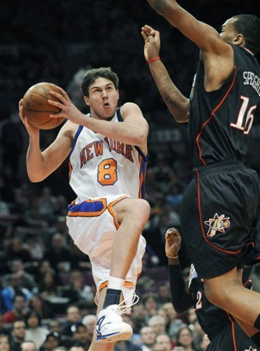 New York Knicks' Danilo Gallinari, left, of Italy, drives to the basket as he is guarded by Philadelphia 76ers' Marreese Speights, right, during the second quarter of an NBA basketball game Saturday night, Jan. 17, 2009 at Madison Square Garden in New York.  (AP Photo/Bill Kostroun)