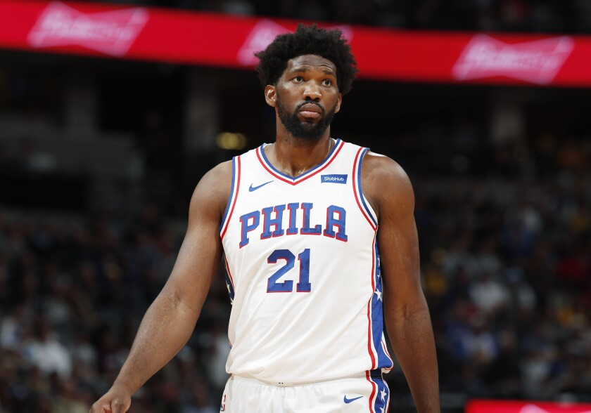 Philadelphia 76ers center Joel Embiid looks to the bench during a break in the first half of an NBA basketball game against the Denver Nuggets, Friday, Nov. 8, 2019, in Denver. (AP Photo/David Zalubowski)