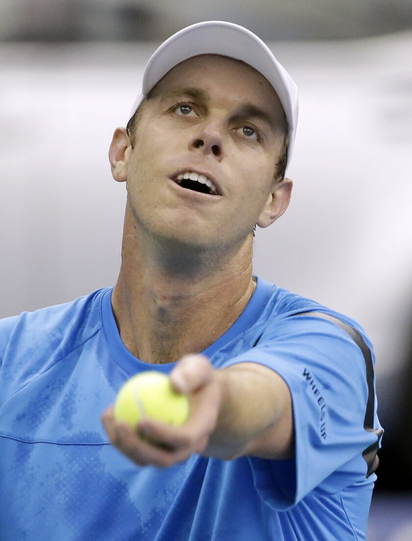 Sam Querrey tosses the ball on a serve to Yoshihito Nishioka, of Japan, in a quarterfinal at the Memphis Open tennis tournament Friday, Feb. 12, 2016, in Memphis, Tenn. (AP Photo/Mark Humphrey)