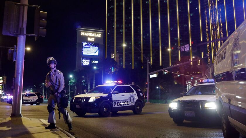 Police officers stand along the Las Vegas Strip the Mandalay Bay resort and casino during a shooting