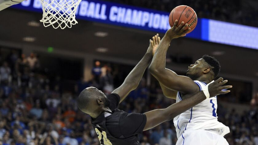 Duke's Zion Williamson, right, shoots over Central Florida's Tacko Fall during the second half of a