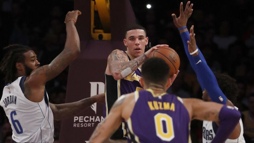 LOS ANGELES, CALIF. - OCT. 31, 2018. Lakers guard Lonzo Ball dishes an assist to teammate Kyle Kuzma