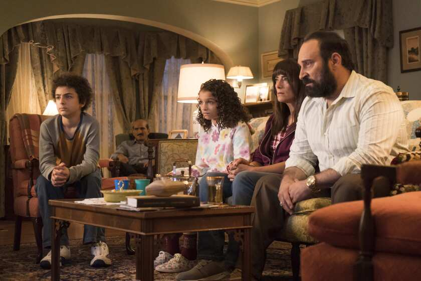 Ramy and family watching the news in the 9/11 episode of 'Ramy'