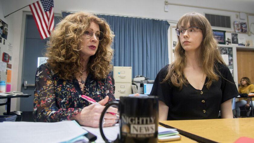 In this April 26, 2019 photo, Bear Creek High School student newspaper advisor Kathi Duffel, left, a