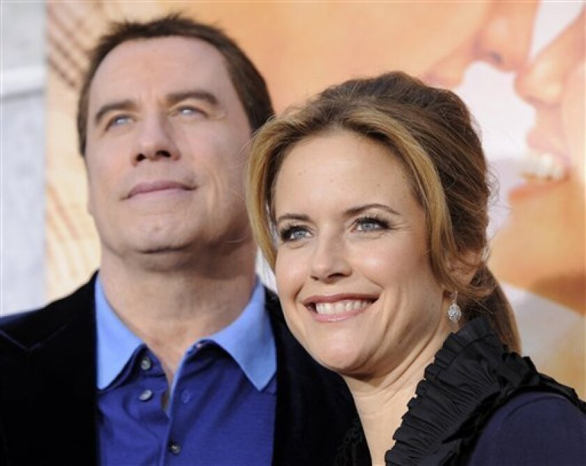 A March 25, 2010 file photo shows Kelly Preston, right, with her husband John Travolta at a movie premiere in Los Angeles.